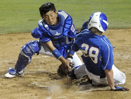 (Will Lester/Staff Photographer) North Bothell Catcher Austin Baek Tags Out Oregon's Cameron Davis At The Plate During The 5th Inning Thursday. Bend South Little League, From Bend, Oregon Upsets Top Seed North Bothell Little League, From Bothell, Washington, 4-3 Thursday August 11, 2011 In The Second Of Two Semifinal Games At The 2011 Little League Northwest Regionals At Al Houghton Stadium In San Bernardino. Oregon Will Face Montana Saturday For The Northwest Championship.
